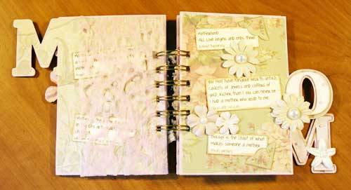mother mini book - opened to reveal torn vellup sheets.