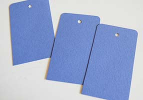 hole punched tags and rounded corners