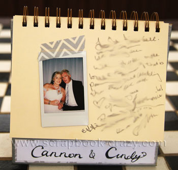 instax polaroid photo in a hand made wedding guestbook.